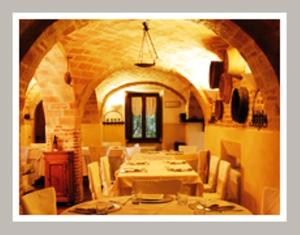 A restaurant or other place to eat at Albergo Le Case