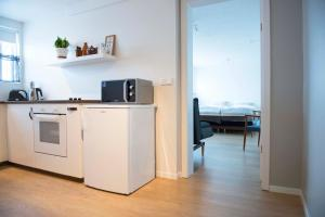 A kitchen or kitchenette at Natura Apartments