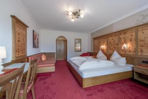 Ein Bett oder Betten in einem Zimmer der Unterkunft Apart Wiesengrund