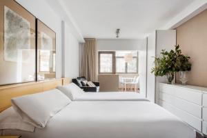 Cama o camas de una habitación en Barcelona Apartment Aramunt
