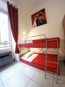 A bunk bed or bunk beds in a room at Palladini Hostel Rome