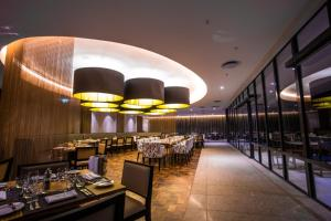 A restaurant or other place to eat at Radisson Blu Okoume Palace Hotel, Libreville