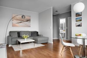 A seating area at IRS ROYAL APARTMENTS Apartamenty IRS Aviator