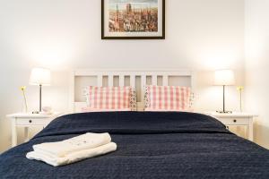 Łóżko lub łóżka w pokoju w obiekcie Marinus Apartments Gdansk