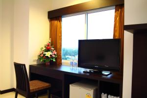 A television and/or entertainment centre at The White Pearl Hotel