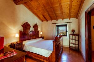 A bed or beds in a room at Cascina La Palazzina