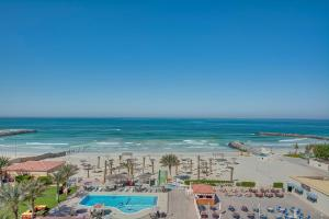 A view of the pool at Ajman Beach Hotel or nearby