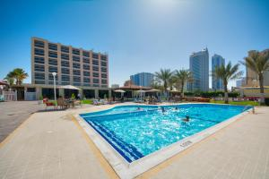 The swimming pool at or close to Ajman Beach Hotel