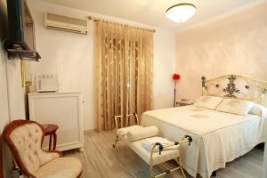 Кровать или кровати в номере Hostal Jiménez