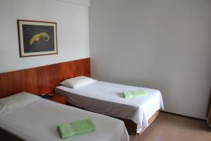 A bed or beds in a room at Flatgyn La Residence
