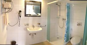 Ein Badezimmer in der Unterkunft Gästehaus Sonne