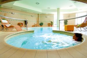 The swimming pool at or near Relais Cappuccina