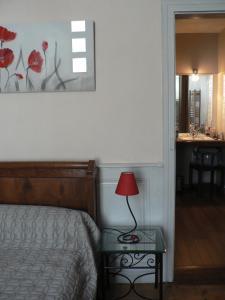 Un ou plusieurs lits dans un hébergement de l'établissement La Terrasse de la Grand'Rue - chambre d'hôtes -