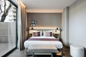 A bed or beds in a room at Upper Diagonal