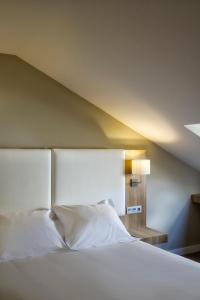Cama o camas de una habitación en Hotel Los Lagos Nature