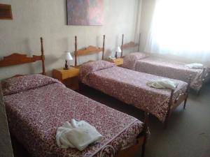 Una cama o camas en una habitación de Crillon Pinamar