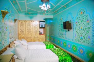 Кровать или кровати в номере Hotel Hon Saroy