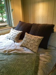 A bed or beds in a room at Chez Marguerite Luxury Shepherd's Hut
