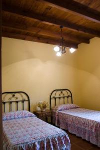 Säng eller sängar i ett rum på Rural Montes Málaga: Finca Pedregales