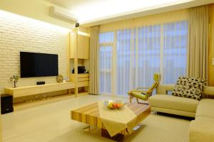 A seating area at Buenos Garden Home Stay