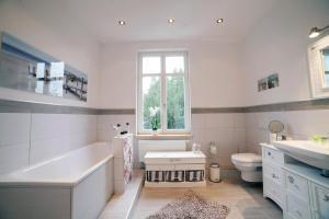 Ein Badezimmer in der Unterkunft DesignLodge Apartments