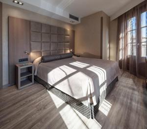 Ein Bett oder Betten in einem Zimmer der Unterkunft Hotel Suizo