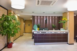 The lobby or reception area at Melqart Hotel