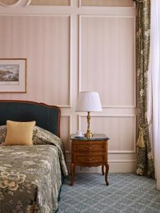 A bed or beds in a room at Grand Hotel Wien