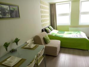 A bed or beds in a room at Apartment Villa Ksenija
