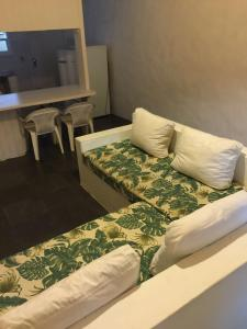 A bed or beds in a room at Vila Giulia