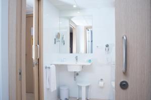 Un baño de Aparthotel Acualandia