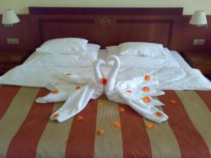 Een bed of bedden in een kamer bij Hotel Villa