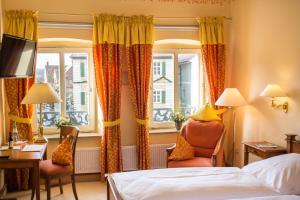 Ein Bett oder Betten in einem Zimmer der Unterkunft Romantik Hotel Greifen-Post