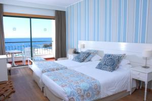 A bed or beds in a room at Quinta Da Penha De Franca