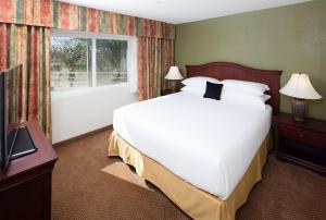 A bed or beds in a room at Red Lion Inn & Suites Perris