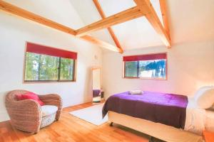 A bed or beds in a room at Morino Chalets