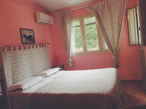 Letto o letti in una camera di B&B Xenia