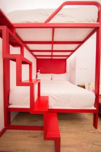 A bed or beds in a room at SleepBox Hotel