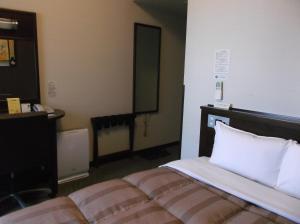 ホテルルートイン弘前駅前にあるベッド