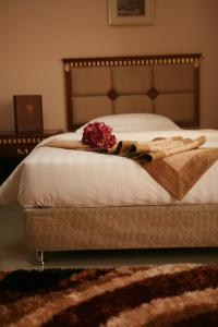 A bed or beds in a room at Crown Hotel Juba