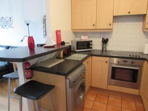 A kitchen or kitchenette at Wexford Town Centre Apartment