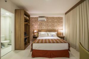 Cama ou camas em um quarto em Promenade Fusion Itaguaí