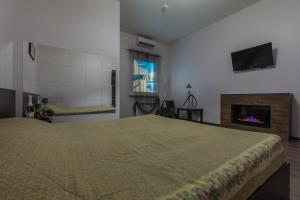 Кровать или кровати в номере Мини-отель на Садовой