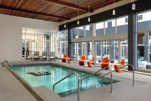 The swimming pool at or near Aloft Montreal Airport