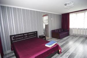 A bed or beds in a room at Guest House Belaiya Magnolia