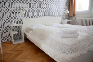 A bed or beds in a room at Classical House in Prague 6