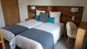 A room at Hotel Du Clocher
