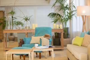 Ein Sitzbereich in der Unterkunft Myseahouse Neptuno