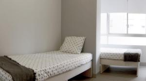 A bed or beds in a room at La Madriguera Hostel