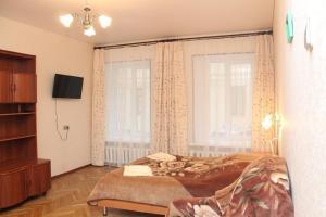 Кровать или кровати в номере PiterFlat - Апартаменты на Гороховой 30
